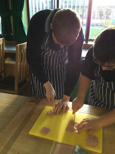 Preparing ingredients using the correct chopping board to make a ham and cheese toastie